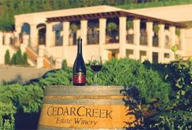 Cedar Creek Barrel in front of the Vineyards Restaurant