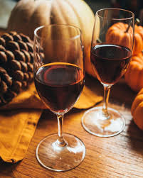 Festive Wines - Redwine Glasses amongst Pumpkins