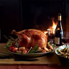 Cooked Turkey with Festive Wine Bottle and Glasses beside